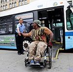 person in wheelchair by bus