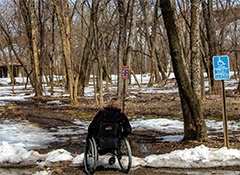 person in wheelchair in melting snow